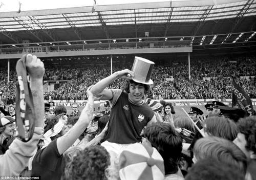West Ham United's Trevor Brooking is chaired by jubilant fans after his team's 2-0 win in the 1975 FA Cup final