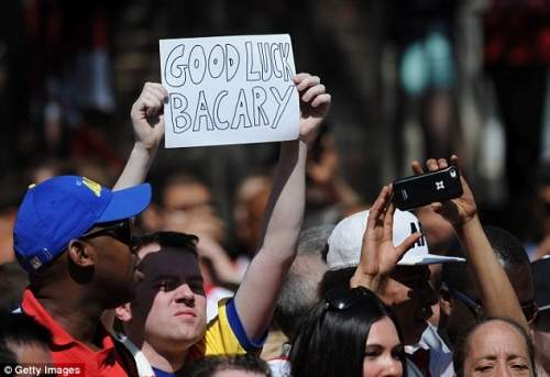 Bon voyage: An Arsenal fan bids farewell to Bacary Sagna, who is expected to leave the club