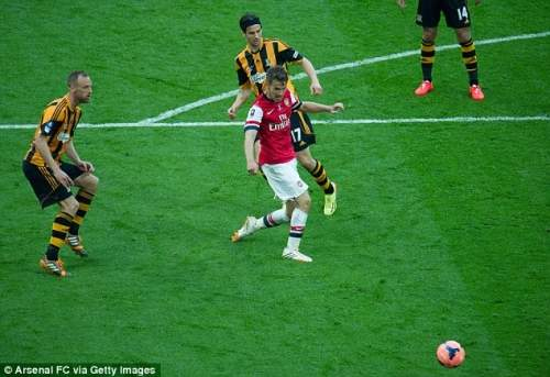 Enter the Dragon: The Welshman scored the extra-time winner as Arsenal came back to beat Hull 3-2