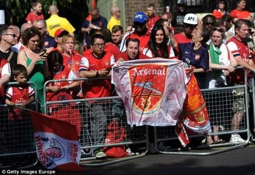 To be a Gooner! Thousands of Arsenal fans have flooded the streets of Islington to celebrate their side's win
