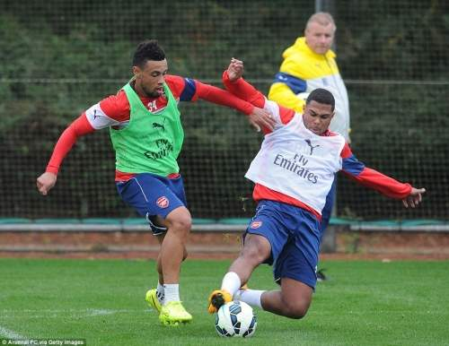 Gnabry flies in to a tackle on team-mate Francis Coquelin and showed no ill-effects from his lengthy injury lay-off