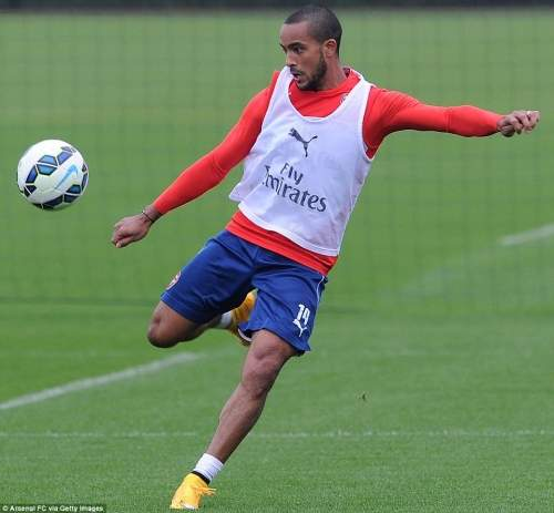The winger prepares to strike a volley during Arsenal's training session on Monday as he moves closer to full fitness
