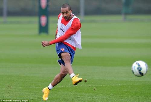 Walcott looks comfortable as he connects with a free-kick during the session and is in line to return against Hull on Saturday