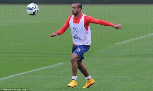 Walcott keeps his eye on the ball during Monday's training session as he continued his recovery from injury
