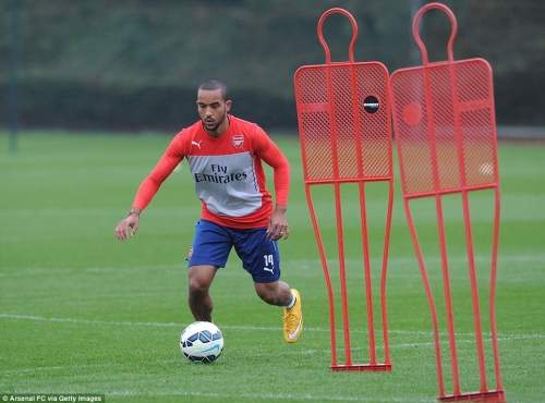 Walcott dribbles round some mannequins at London Colney as he prepares to face real, Premier League opponents
